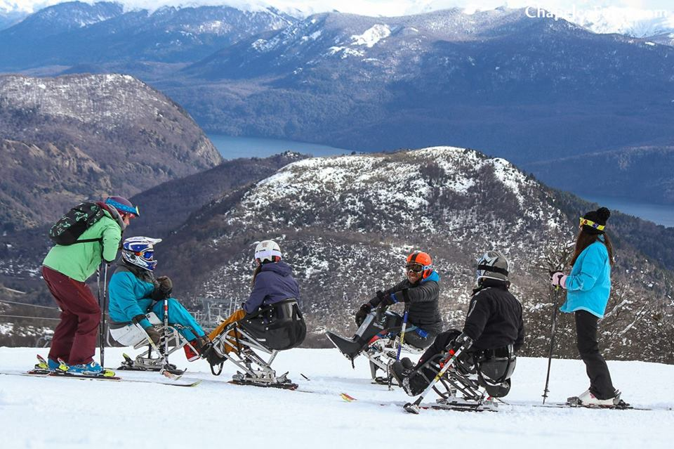 <p>People enjoying adaptive ski in the mountains.</p>